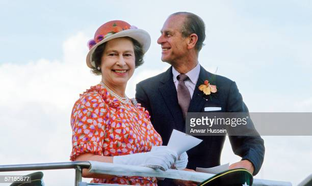 Queen Elizabeth ll and Prince Phillip the Duke of Edinburgh smile during a visit to Fiji in February of 1977