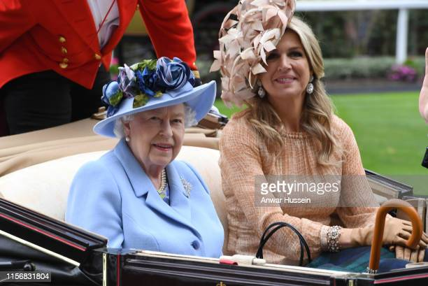 Queen Elizabeth ll and Queen Maxima of The Netherlands arrive in an open carriage to attend day one of Royal Ascot on June 18, 2019 in Ascot, England.