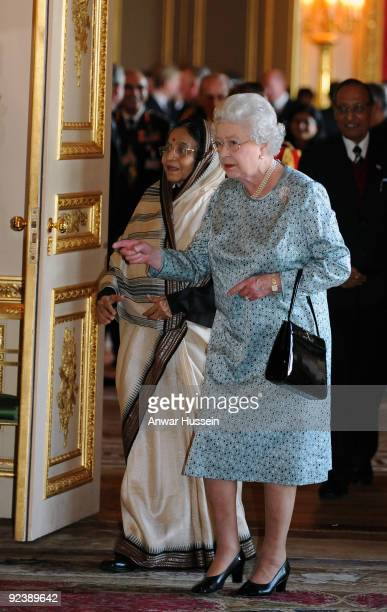 Queen Elizabeth ll and the President of India Pratibha Patil enter the White Drawing Room at Windsor Castle to view an exhibition of items at the...