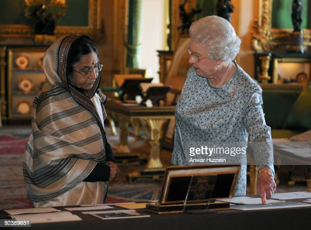 Queen Elizabeth ll and the President of India Pratibha Patil view an exhibition of items in the White Drawing Room at Windsor Castle at the start of...