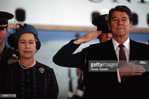 Queen Elizabeth ll and US President Ronald Reagan salute the American National Anthem during a welcome ceremony on March 01 1983 in Santa Barbara USA