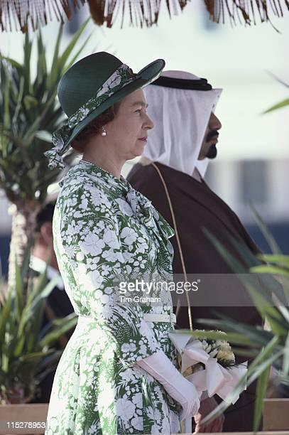 Queen Elizabeth ll andKhalifa bin Hamad bin Abdullah bin Jassim bin Muhammed Al Thani the Emir of Qatar stand as national anthems are played to...