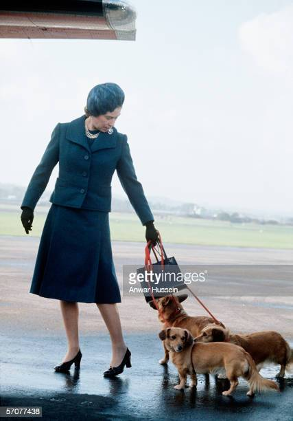 Queen Elizabeth ll arrives at Aberdeen Airport with her corgis to start her holidays in Balmoral Scotland in 1974