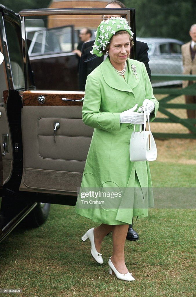 Queen Elizabeth Ll Arriving Polo At Smiths Lawn Windsor After Ascot Races Wearing A Silk Mint Green Coat And Matching Dress With A Green And White Hat Designed By Milliner Simone Mirman.