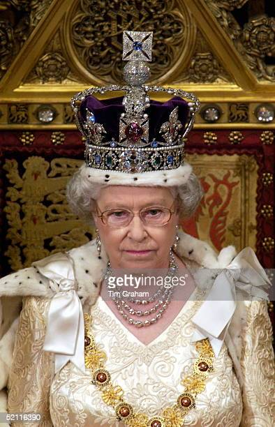 Queen Elizabeth Ll At The State Opening Of Parliament Seated On A Throne In The House Of Lords In The Palace Of Westminster And About To Make Her...
