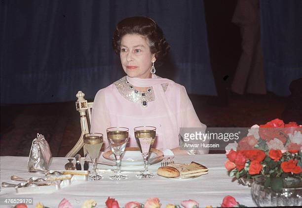 Queen Elizabeth ll attends a State Banquet on October 25, 1980 In Algiers, Algeria. The Queen's necklace and earring are part of The King George Vl...