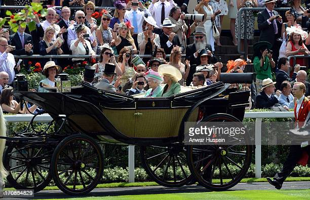 Queen Elizabeth ll Camilla Duchess of Cornwall and Prince Charles Prince of Wales arrive in an open carriage to attend Day 2 of Royal Ascot at Ascot...