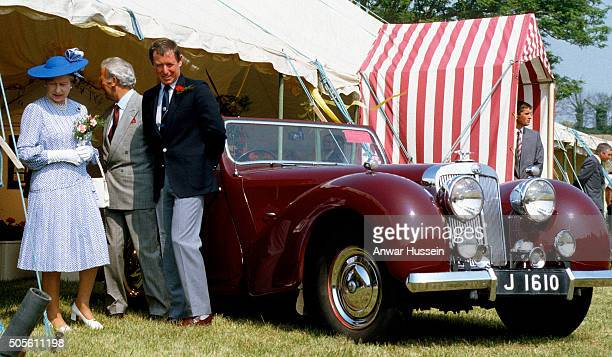 Queen Elizabeth ll chats to actor John Nettles, who plays the part of Jersey detective Bergerac, during her visit to the Channel Islands on May 25,...