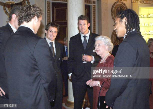 Queen Elizabeth ll chats with members of the All Blacks New Zealand rugby team, November 14 during a special reception at Buckingham Palace in...