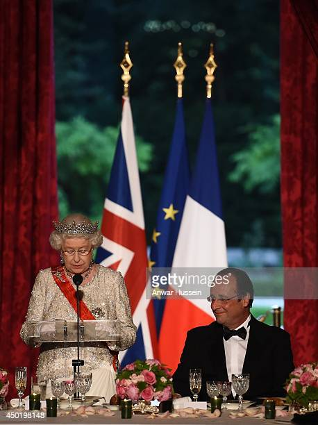 Queen Elizabeth ll delivers a speech during a State Banquet hosted by French President Francois Hollande at the Elysee Palace on June 6, 2014 in...
