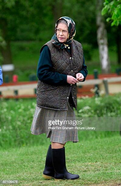 Queen Elizabeth Ll, Dressed Casually In A Wool Skirt, Body Warmer And Wellington Boots, As She Walks Through The Grounds Of Windsor Great Park During...