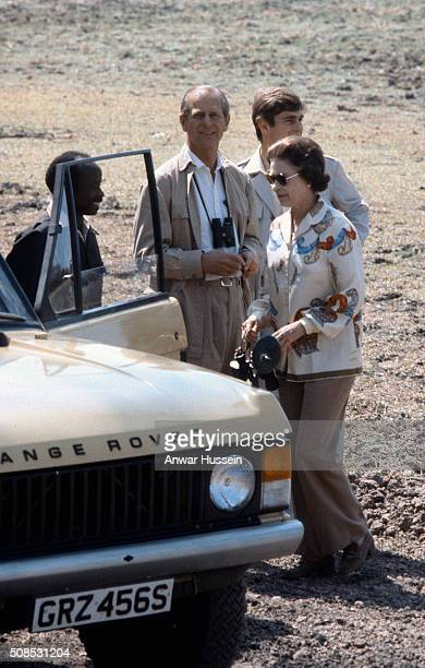 Queen Elizabeth ll dresses casually in trousers and she visits a game reserve in Zambia with Prince Philip Duke of Edinburgh and Prince Andrew on...