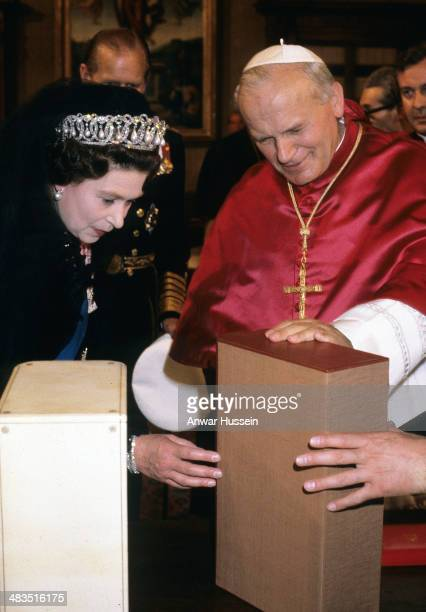 Queen Elizabeth ll exchanges gifts with Pope John Paul ll during a visit to the Vatican on October 17, 1980 at The Vatican, Italy.
