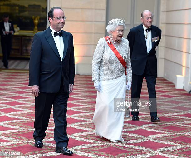 Queen Elizabeth ll, French President Francois Hollande and Prince Philip, Duke of Edinburgh arrive for a State Banquet at the Elysee Palace on June...