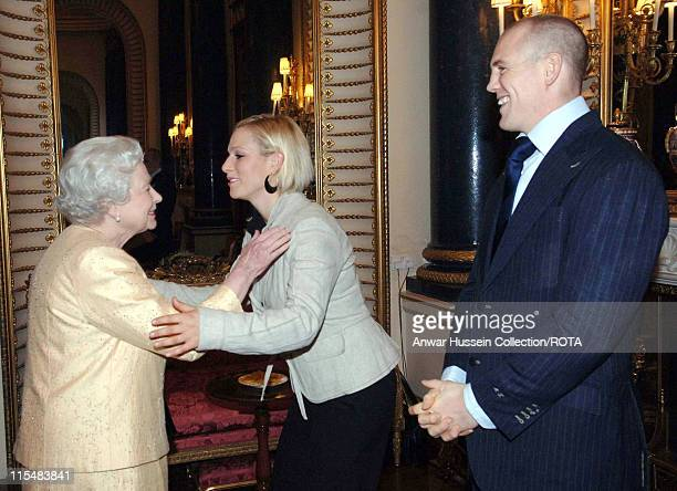 Queen Elizabeth ll greets her granddaughter, Zara Phillips, and boyfriend, English rugby player Mike Tindall, at a Buckingham Palace reception for...