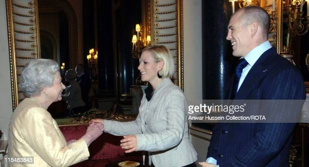 Queen Elizabeth ll greets her granddaughter Zara Phillips and boyfriend English rugby player Mike Tindall at a Buckingham Palace reception for the...