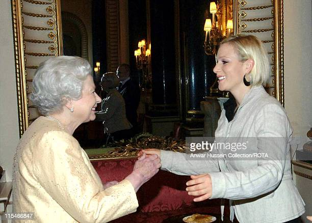 Queen Elizabeth ll greets her granddaughter, Zara Phillips at Buckingham Palace reception for the country's top achievers on December19, 2006 in...