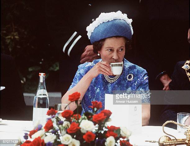 Queen Elizabeth ll has a cup of tea while in Northern Ireland on a royal visit in 1977