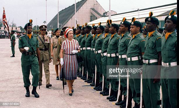 Queen Elizabeth ll inspects a guard of honour as she arrives in Barbados on October 31, 1977 in Barbados.