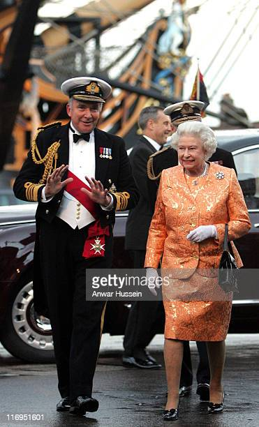 Queen Elizabeth ll is escorted by First Sea Lord Admiral Sire Alan West as she arrives at Portsmouth Naval base to mark the 200th anniversary of the...