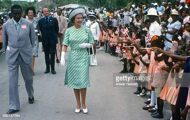 Queen Elizabeth ll is greeted by the public during a walkabout in Barbados on November 01 1977 in Barbados