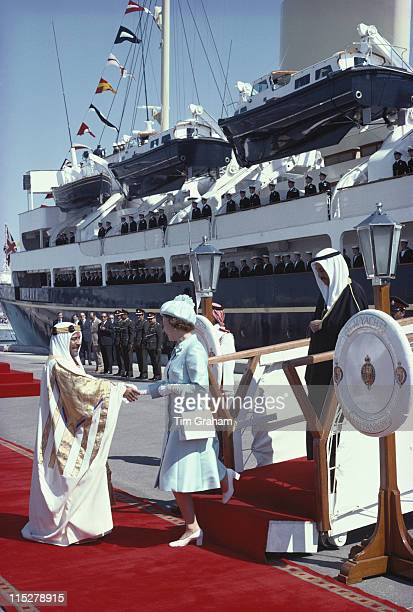 Queen Elizabeth ll is welcomed by Isa bin Salman Al Khalifa the Emir of Bahrain upon leaving the Royal yacht Britannia on her arrival in Bahrain as...