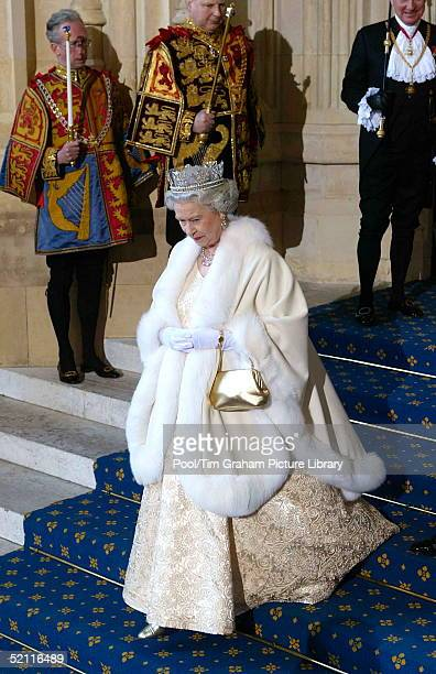 Queen Elizabeth Ll Leaving The Houses Of Parliament After The State Opening Of Parliament The Queen Is Wearing A Diamond Crown Known As The State...