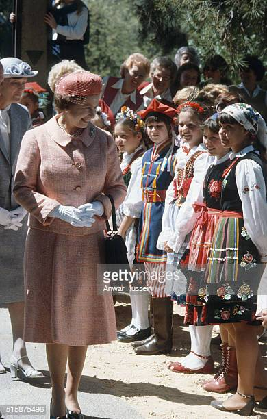Queen Elizabeth ll meets children wearing national costumes during a visit to Australia on October 01 1981 in Tasmania Australia