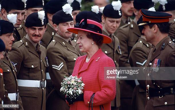 Queen Elizabeth ll meets members of the Royal Welch Fusiliers at Powis Castle on her birthday April 21, 1989 in Powis, Wales.