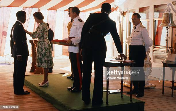 Queen Elizabeth ll performs an investiture on board the Royal Yacht Britannia on October 01 1977 in Nassau Bahamas