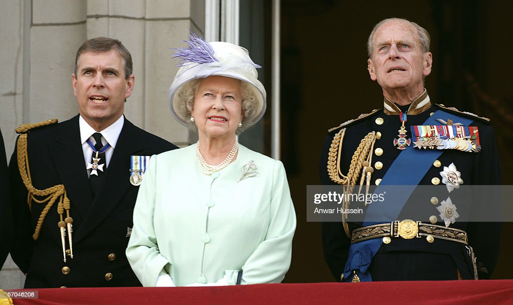 Queen Elizabeth ll, Prince Andrew, Duke of York and Prince Phillip, Duke of Edinburgh watch the flypast over the Mall of British and US World War 11 aircraft from the balcony of Buckingham Palace on National Commemoration Day July 10, 2005.