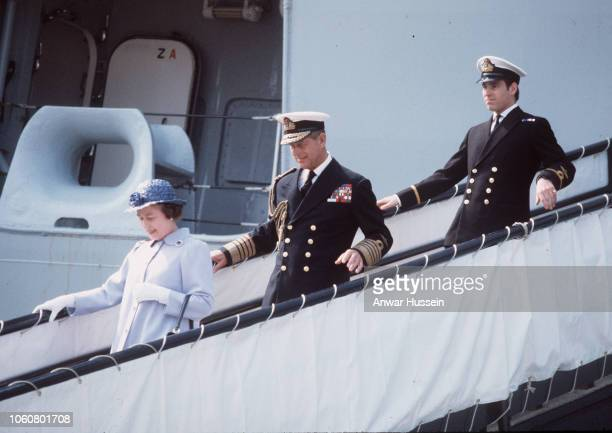 Queen Elizabeth ll Prince Philip Duke of Edinburgh and Prince Andrew disembark from HMS Invincible when Prince Andrew returns from the Falklands war...