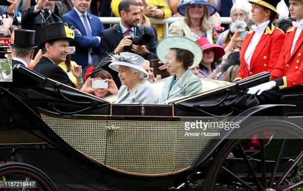 Queen Elizabeth ll, Princess Anne,The Princess Royal and Sir Timothy Laurence arrive in an open carriage to attend Ladies Day at Royal Ascot on June...