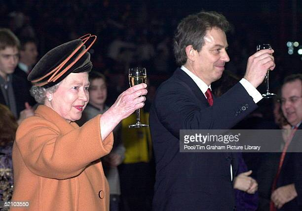 Queen Elizabeth Ll Raising Her Champagne Glass In A Toast With Prime Minister Tony Blair To Welcome In The New Year During The Millennium...