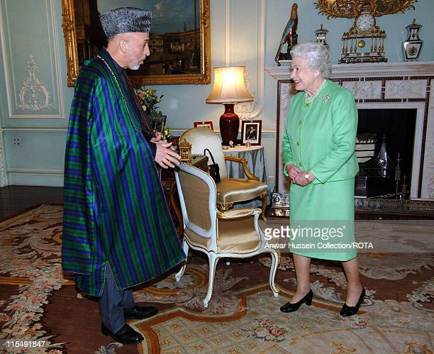 Queen Elizabeth ll receives the President of Afghanistan, Hamid Karzai, in the Private Audience Room at Buckingham Palace on October 24, 2007 in...