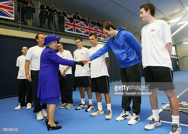 Queen Elizabeth ll shakes hands with British tennis star Greg Rusedski as she visits the new National Tennis Centre in Roehampton on March 27, 2007...