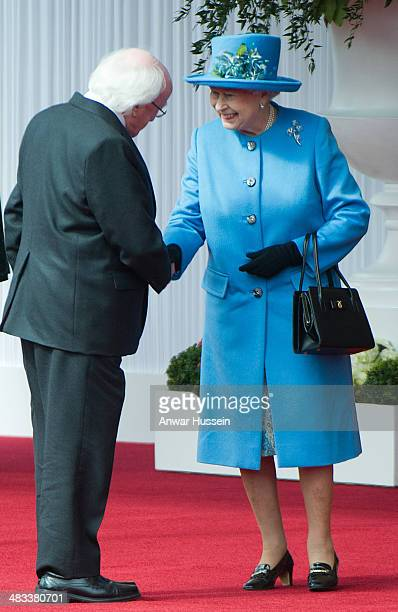 Queen Elizabeth ll shakes hands with the Irish President Michael D Higgins during a ceremonial welcome on April 08 2014 in Windsor England