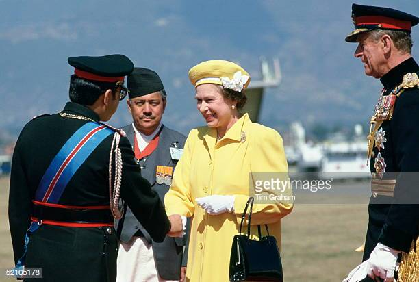 Queen Elizabeth Ll Shaking Hands With King Birendra As She And Her Husband Prince Philip Arrive For Their Official Tour Of Nepal