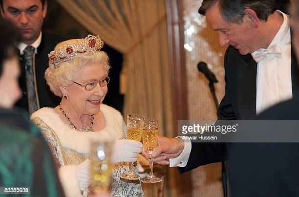 Queen Elizabeth ll shares a toast with President Danilo Turk during a State Banquet at Brdo Castle on the first day of a State Visit to Slovenia on...