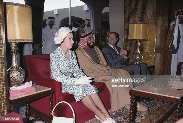 Queen Elizabeth ll Sheikh Zayed bin Sultan Al Nahyan Prince Philip seated before lunch at the Hilton Hotel in Abu Dhabi United Arab Emirates as part...