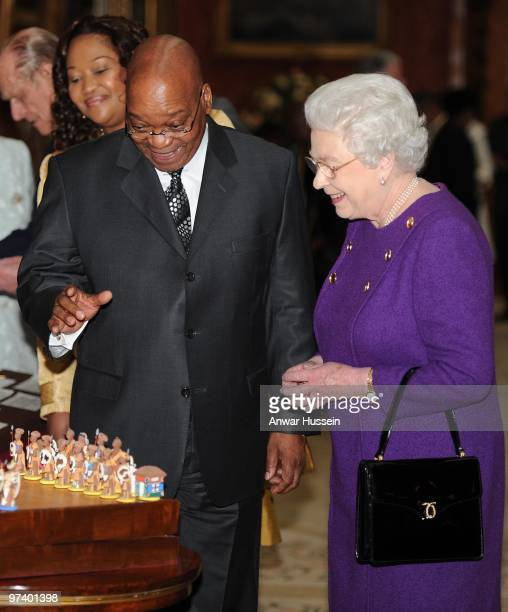 Queen Elizabeth ll shows South African President Jacob Zuma and wife Thobeka Madiba Zuma an exhibition of South African items from the Royal...