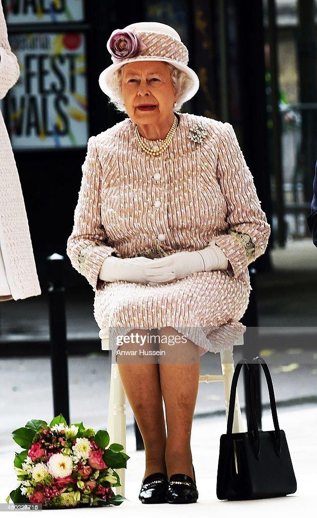 Queen Elizabeth ll sits to listen to a speech as she visits the Marche aux Fleurs et aux Oiseaux on June 7, 2014 in Paris, France.
