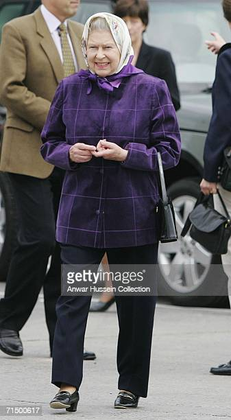 Queen Elizabeth ll smiles as she arrives in headscarf and trousers to embark on the Hebridean Princess at Port Ellen for a week long cruise around...