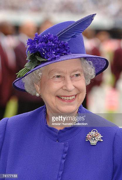 Queen Elizabeth ll smiles as she is presented to the English and West Indian cricket teams during the first N-Power Test Match at Lords on May 17,...