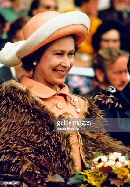 Queen Elizabeth ll smiles as she wears a Maori cloak in New Zealand in February of 1977.
