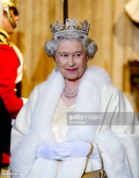 Queen Elizabeth ll smiling as she arrives at the Palace of Westminster for the State Opening of Parliament The Queen is wearing a diamond crown known...