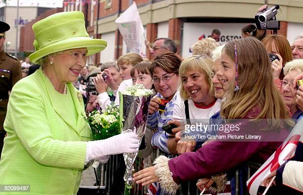 Queen Elizabeth Ll Smiling As She Is Given Flowers From A Girl In The Crowd During A Walkabout In Jubilee Walk The Queen Has Just Left The Islamic...