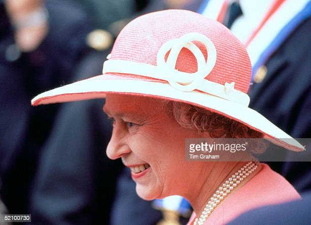 Queen Elizabeth Ll Smiling As She Watches The British Commemorative Parade Before Attending A Service For The 50th Anniversary Of D-day.