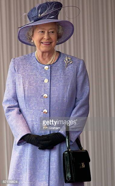 Queen Elizabeth Ll Smiling During The State Visit Of The American President At Buckingham Palace. The Queen Is Wearing A Mauve Coat With Matching Hat...