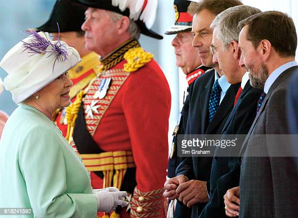 Queen Elizabeth ll speaks with state officials at Buckingham Palace during a State Visit by President Putin of the Russian Federation